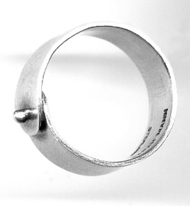 "RIVET $95-sterling silver ring with sanding disk texture on band (3/16"" wide band) made to size specifications"